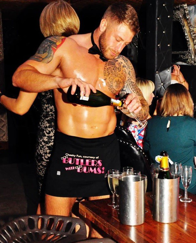 Naked Butler Pouring Drinks