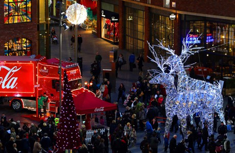 Christmas lights in Liverpool. Shoppers pass the Christmas lights and the Coca-Cola truck at Liverpool 1 in Liverpool City Centre. Issue date: Wednesday November 27, 2013. Photo credit should read: Peter Byrne/PA Wire URN:18329874